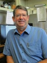 Dr. Daniel Howe sitting at his desk.
