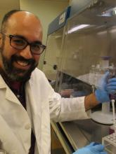 Dr. Carlos Lopez working under the PCR hood.