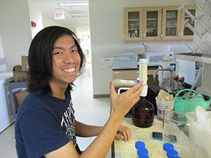 ABT student preparing ground wheat samples in the lab.