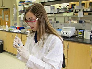 ABT student labeling tubes in the lab.